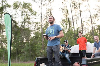 Lead Pastor Tim Ingram led a worship service Friday from the back of a pickup truck after the church closed on the land for its new campus.
