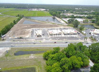 This aerial photograph, taken in June, shows the Oviedo Point development on Mitchell Hammock Road. The two buildings in the center are a multi-tenant retail center that sold this month; the building on the left is a Dairy Queen, and a WaWa service station/market is to the right.