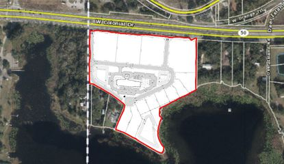 The conceptual site plan for Johns Lake Point PUD features four commercial/retail lots fronting S.R. 50 and an assisted/independent living facility next to eight large, waterfront single-family homes.