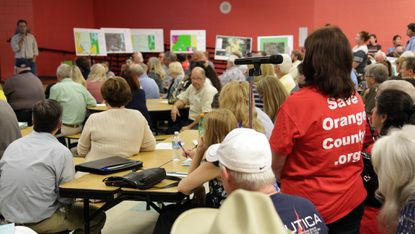 Dwight Saathoff, developer of The Grow, answers questions during one of the community meetings that were held with area residents, the vast majority of which were against the project.