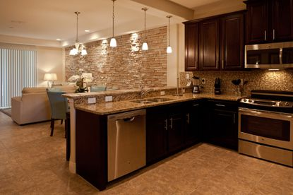 A look at the kitchen and living room of a townhome at The Fountains at ChampionsGate, which opened on June 1.