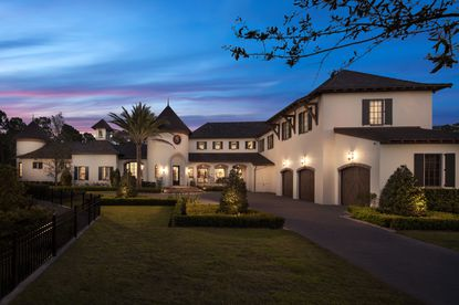 The seven bedroom house in Disney's exclusive Golden Oak community was designed in the French Provincial style.