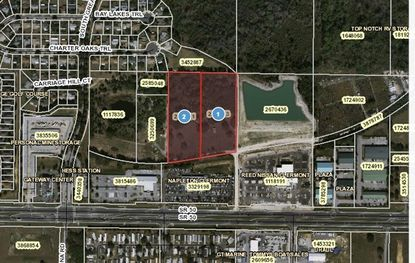 Napleton Clermont Chrysler buys land behind dealership on S.R. 50 for expansion.