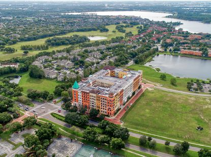 An aerial view of the five-story Residences at Veranda Park project in Orlando's MetroWest neighborhood.