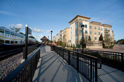 Wendover Housing Partners built the transit-oriented Weston Park apartments across from the Longwood SunRail station. Now one of the firm's top executives is teaming up with Lennar to add townhomes to the community.