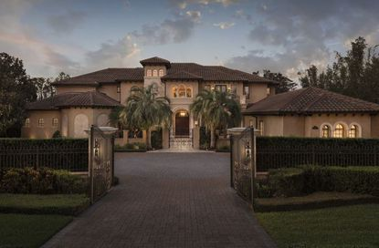 Medical clinic chain owner pays $4M+ for former NFL star's Windermere home