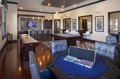 Partial view of a games and entertainment room at the former GrandeVille at Jubilee Park apartments in LeeVista Center, which was purchased this week and rebranded.