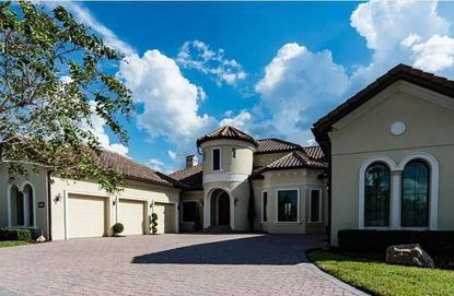 An IT author and his wife recently bought this Alaqua Lakes Estates home for $1.4 million.