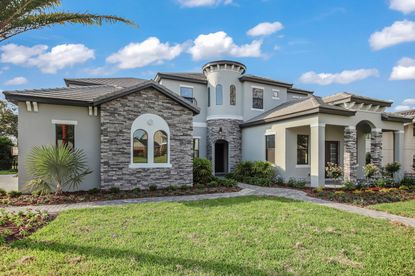 Unicorp National Development President Chuck Whittall bought a 1979 house in Bay Hill, razed it and built this six-bedroom spec house.