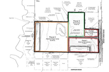 Outlined in black is the subject 75 acres south of Orlando International Airport on Boggy Creek Road. A new Land Use Plan would designed 30.94 acres for attached single-family homes (orange), 14.62 acres for apartments (green), and 20.4 acres fronting the road for mixed-use commercial (red).