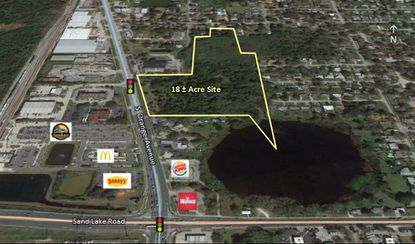 Outlined in yellow are the 18 acres across from the Sand Lake SunRail station.