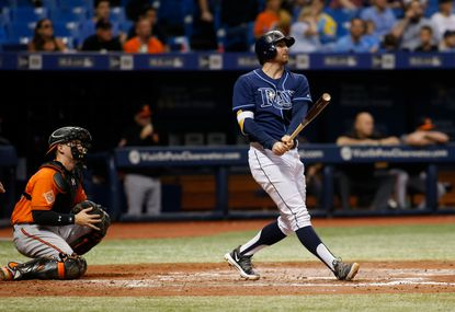 Brad Miller of the Tampa Bay Rays (blue) hits a three-run home run in the fourth inning of a game against the Baltimore Orioles on Sept. 30 of this year at Tropicana Field.