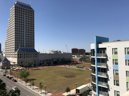 Outlined in red is the 3.57-acre undeveloped parcel at 434 N. Orange Ave.; this view looks south along Orange Avenue from the Orange County Courthouse, with the Central Station on Orange apartments on the right side of the frame and 28-story Bank of America tower to the left.