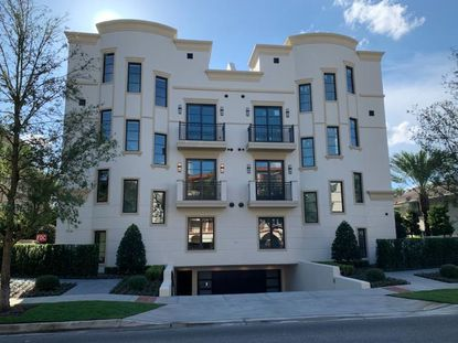 Three of the six units in this luxury townhouse building on Winter Park's Interlachen Avenue have sold in the last month for an average of $2.8 million. The building features rare amenity: underground parking.