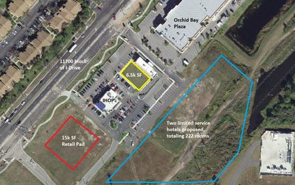 A view of Phoenicia Development's remaining land in the 11700 block of International Drive that is available, with new plans for inline retail (yellow outline) and 5.04 acres under contract to hotel developer B.P. Sodhi (blue).
