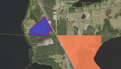 The parcel in blue is under contract by IBI Group, which is eying the 102 acres on U.S. 192 for a 400-home mixed use development. It's located just northwest of Harmony (shown in orange).