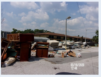 Osceola County has initiated foreclosure actions against the owner of two Kissimmee motels on the W192 tourism corridor. This photo shows the junk violations cited at the Lake Cecile Inn & Suites at 4900 W Irlo Bronson Memorial Hwy.