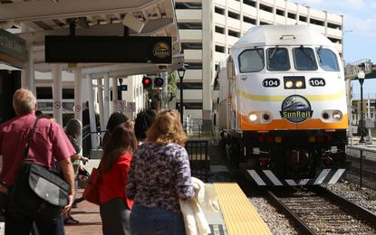 Passengers await the northbound train at SunRail's Church Street Station.