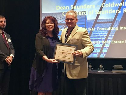 Parker Consulting's Brad Parker was recognized by the Central Florida Commercial Association of Realtors on Wednesday for the top deal in Lake County, the $70+ million sale of Hills of Minneola. Carol Tanner presented the Hallmark Award.