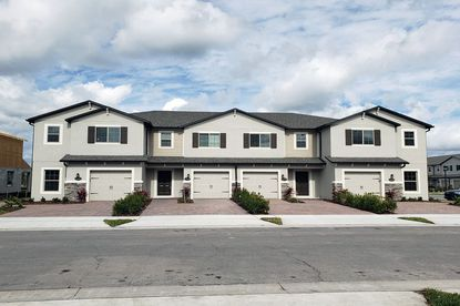 A photo of M/I Homes' Towns at Avalon townhome community in Orlando's Waterford neighborhood.
