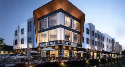 A rendering of one of the multi-story office and retail buildings planned for a mixed-use development in Ocoee at the corner of Maguire Road and the Florida Turnpike.