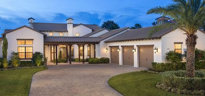 A custom-built home along Emerson Pointe Way located within Bay Hill Country Club.