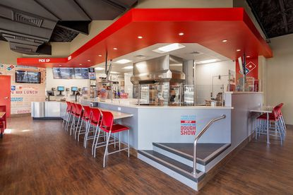 A look at the new design of a renovated Dominos location that Rick Traenkner will introduce to Orlando-area locations, which puts the kitchen closer to an expanded seating area.
