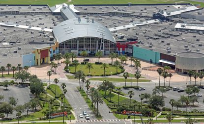 Orlando's Code Enforcement Board said the former Artegon mall, shown here on June 6, isn't zoned for a auto museum and ordered the owner to remove some 1,500 vehicles from the building.