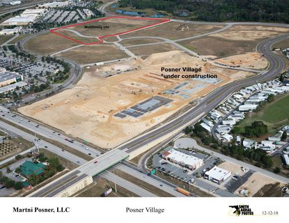 This aerial photo taken Dec. 12 shows the active construction site of Posner Village at the U.S. 27 - I-4 interchange. The proposed multifamly site is outlined in red.