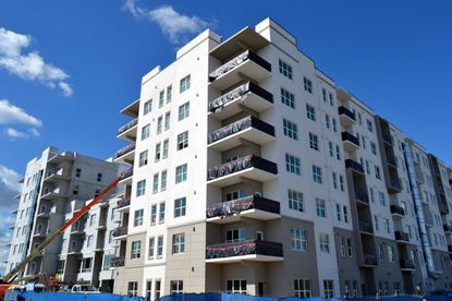 A construction photo from early November of the seven-story, 268-unit Alliance Residential apartments at Ravaudage.