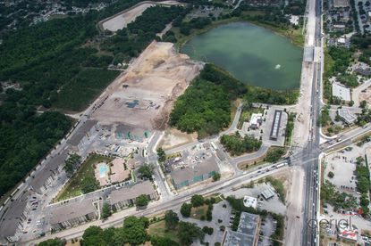 Looking eastward toward Lake Bennet, site work for the City Center West Orange lies northwest of the lake. Running vertically through the photo is W. Colonial Drive, and horizontally is S. Bluford Avenue.
