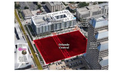 An aerial view of the 3.57 acres in question on N. Orange Avenue, in context with neighboring buildings the Bank of America Center tower, Crescent Central Station apartments, and the Lynx central station.