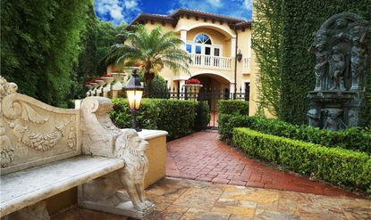 The property features artistic finishes throughout, and contains a three-car garage, large summer kitchen and luxury open-air pool and spa.