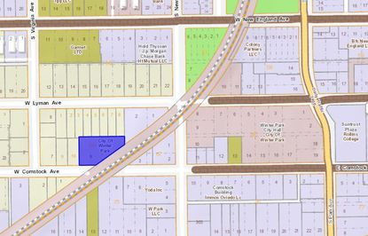 Highlighted in blue is the 0.45-acre parcel at 301 W. Comstock Ave., two blocks south of W. New England Avenue.