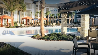 Pool-area marketing photo of the Alexander at Sabal Point apartments in Longwood.