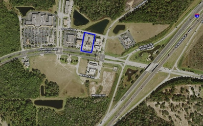 A St. Petersberg developer paid $1.3 million for the 1.3-acre lot outlined in blue. Located just off the I-4 - ChampionsGate interchange, the site is currently home to a Regions Bank branch.