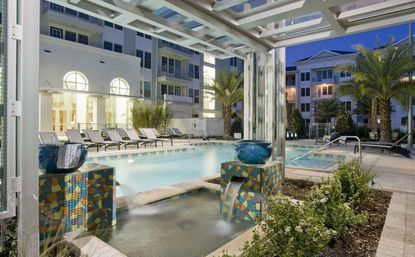 A view of the interior courtyard pool area at Aqua at Millenia apartments, located on Millenia Lakes Boulevard.