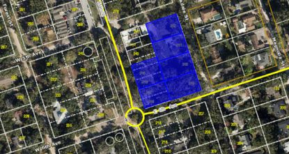 The 2.2-acre lot sits across from a new 11,000-square-foot municipal town complex under construction.