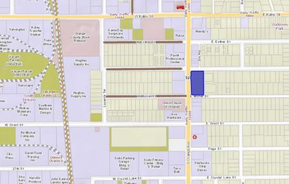 2121 S. Orange Ave. is highlighted in blue, located northeast of the SoDo retail and apartment complex.