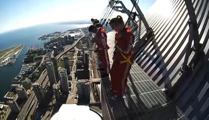 A view of patrons on the EdgeWalk attraction atop the CN Tower in Toronto, which would be replicated at the Skyplex entertainment complex in Orlando in 2019.