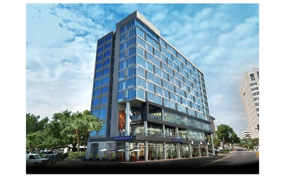 The company that owns downtown Orlando's Aloft hotel plans to build a new 11-story hotel at 500 S. Magnolia Ave., next to the Dr. Phillips Center.