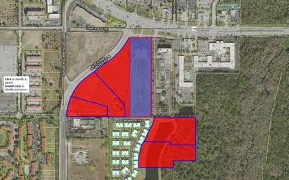 Walmart already owns the parcels shown in red at U.S. 192 and Old Lake Wilson Road. The retailer has applied to rezone the former hotel site next door, shown in blue.
