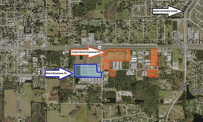 Reich Properties is planning to develop 127,000 square feet of commercial and light industrial on the unfinished business park outlined in blue. Earlier this year, Reich partnered with Daryl Carter to buy the remaining lots in the St. Cloud Industrial Park, shown in orange.