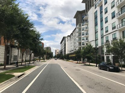 View of downtown Orlando's North Quarter neighborhood, looking northward along the one-way N. Orange Avenue from the Colonial Drive intersection.