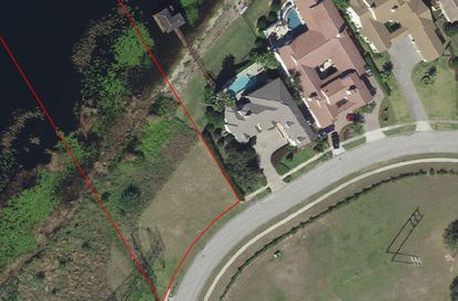 Outlined in red is the recently purchased lot on Emerson Pointe Way near Bay Hill, which was purchased by the owner of the house to its immediate right (gray roof).