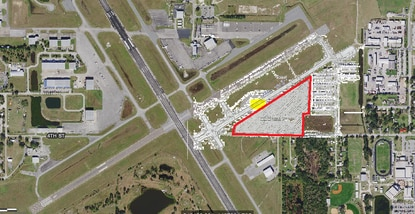 The triangular area outlined in red is the 11-acre parcel at Kissimmee Gateway Airport that the city wants redeveloped. The area highlighted in yellow is a hangar that will be demolished to make way for a new taxiway.