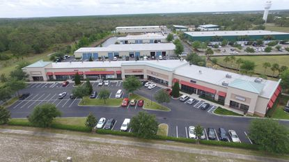 Hanover Capital paid $8.4 million for the retail center and four industrial buildings pictured here. The 10-acre complex is just off S. Orange Blossom Trail, about a quarter-mile from the Poinciana SunRail station. The company also owns the 50,000-square-foot building next door.