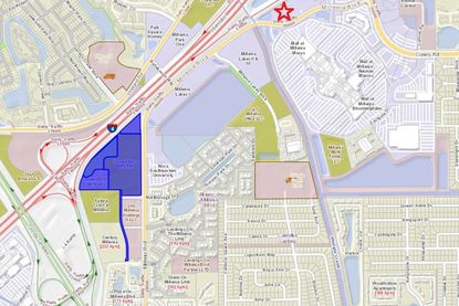 A red star marks the location of Boyland Auto Group's current Mercedes-Benz of South Orlando dealership location, next to Mall at Millenia. Highlighted in blue are 23-plus acres Boyland has bought to relocate and expand the dealership.