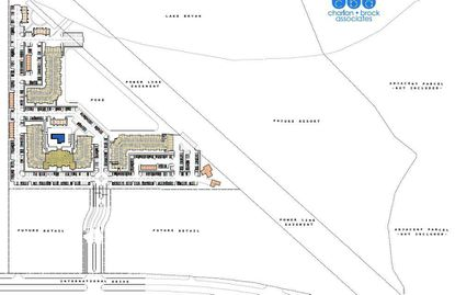 A conceptual site plan, in which north is to the right, showing a proposed apartment complex by ContraVest along Lake Bryan and S. International Drive.