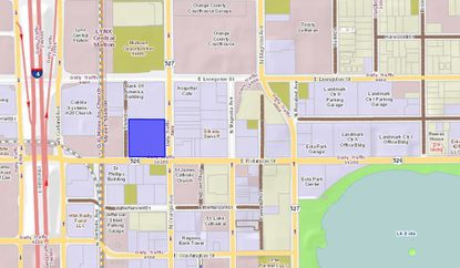 Highlighted in blue are 2.08 acres used as a parking lot by the Diocese of Orlando at the corner of E. Robinson Street and N. Orange Avenue, which serves the adjacent St. James Catholic Church.